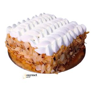 GourmetSucré vous propose Ma Signature, entremets composé d'une génoise noisette, d'un crémeux noisettes et chantilly mascarpone amande intense.